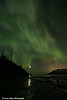 View of the Aurora Borealis (Northern Lights) dancing above the Chugach Mountains and reflecting in the waters of Turnagain Arm, Kenai Peninsula, Alaska<br /> <br /> March 17, 2013
