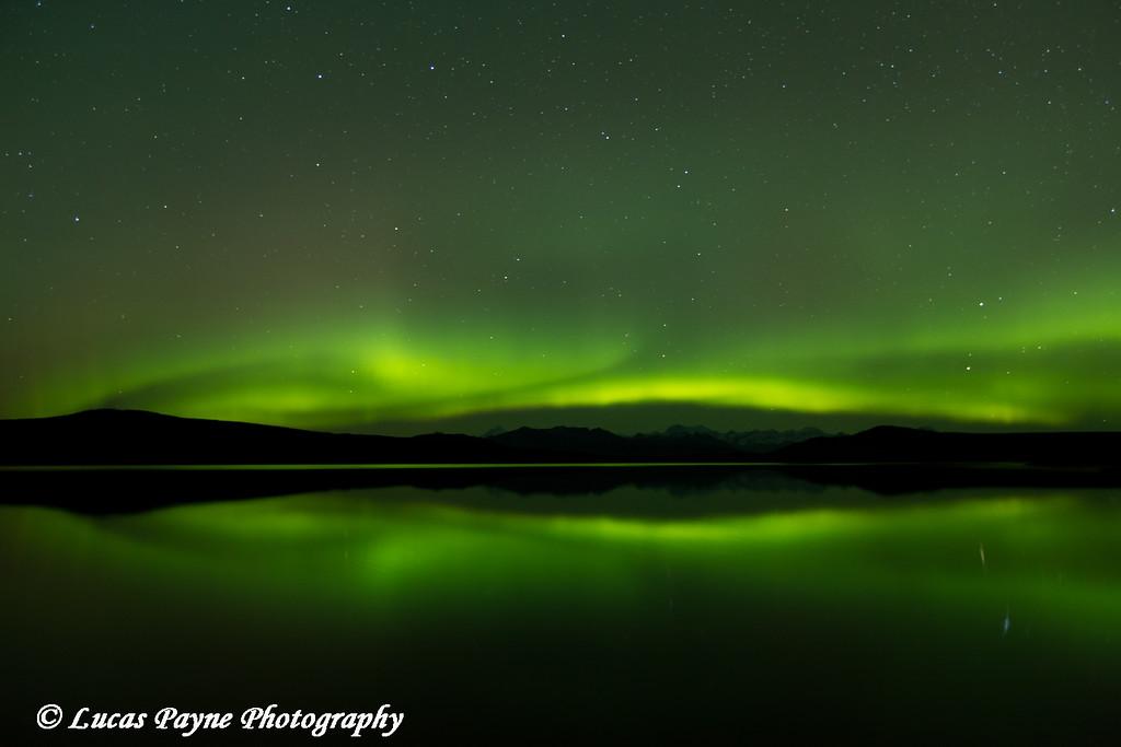 Aurora Borealis (Northern Lights) reflected in 50 Mile Lake along the Denali Highway.<br /> <br /> September 25, 2014