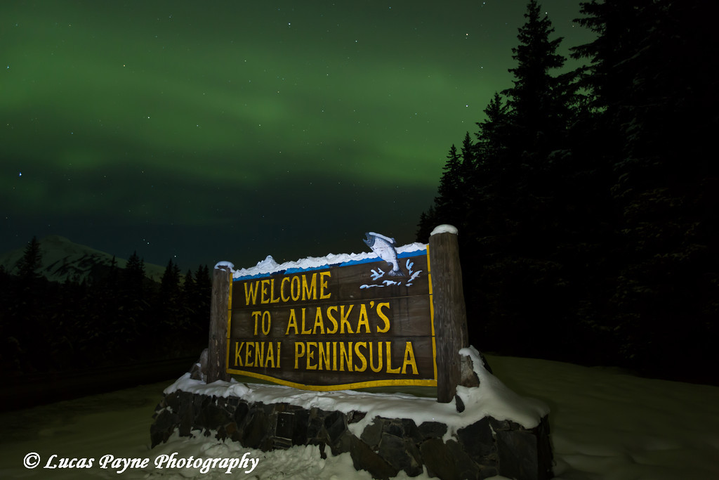 "View of the Aurora Borealis (Northern Lights) dancing above the ""Welcome To Alaska's Kenai Peninsula"" sign, Kenai Peninsula, Alaska<br /> <br /> March 17, 2013"