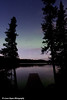 Faint glow of the Aurora Borealis (Northern Lights) over South Rolly Lake in Nancy Lake<br /> September 09, 2011