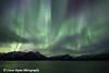 View of the Aurora Borealis (Northern Lights) dancing above the Chugach Mountains and Turnagain Arm, Kenai Peninsula, Southcentral, Alaska.<br /> <br /> November 03, 2015