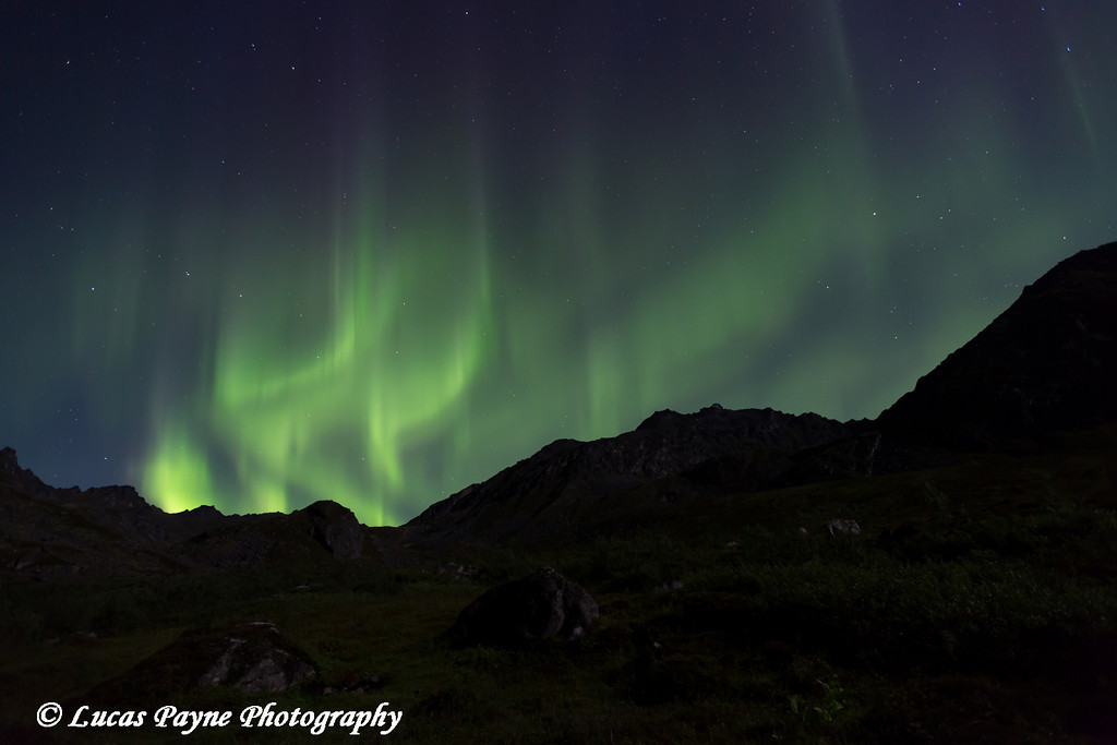 Aurora Borealis (Northern Lights) dancing the Talkeetna Mountains in Archangel Valley, Hatcher Pass, Alaska<br /> <br /> August 24, 2013