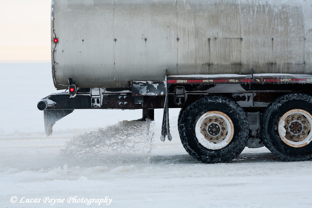 Water Truck Spraying Water Building Ice Road in Prudhoe Bay<br /> February 2011