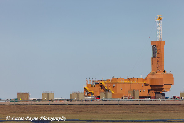Doyon oil rig and well houses on Drill Site 13 in the Prudhoe Bay Oil Field, North Slope, Arctic Alaska<br /> <br /> June 21, 2012