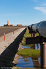 An oil pipeline along the road with Doyon Oil Rig 25 in the Prudhoe Bay Oil Field, North Slope,  Arctic Alaska<br /> <br /> July 19, 2012