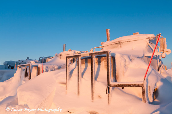 Snow Covered Trucks Prudhoe Bay<br /> February 2011