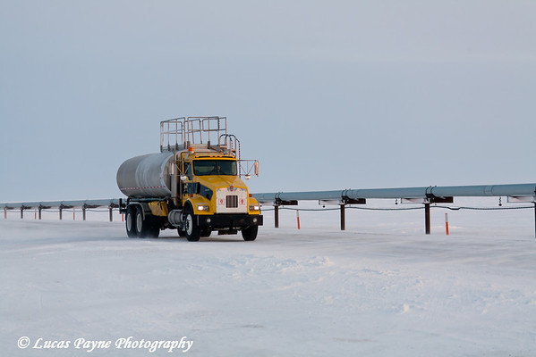 Water Truck Driving Along Pipeline Prudhoe Bay<br /> February 2011