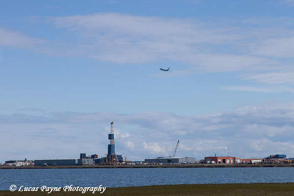 Nabors Oil Rig Z7E along Lake Colleen and a south bound Shared Services Aviation plane flying over Deadhorse, Prudhoe Bay Oil Field, Arctic Alaska.<br /> <br /> July 16, 2013