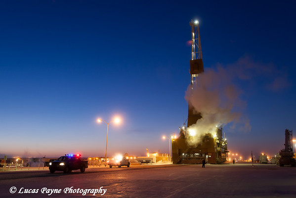 Doyon Oil Rig 14 driving down the road in the Prudhoe Bay Oil Field, North Slope, Arctic Alaska, Winter