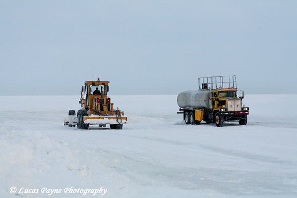 Water Truck and Road Grader Building Ice Road in Prudhoe Bay<br /> February 2011
