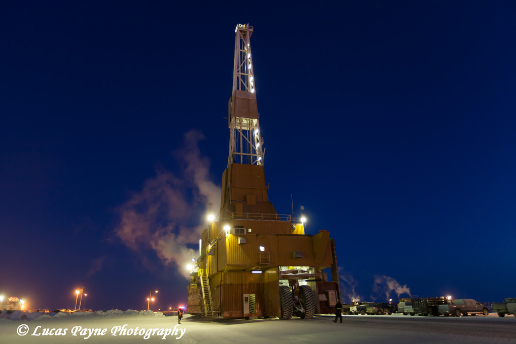 Doyon Oil Rig 14 driving down the road in the Prudhoe Bay Oil Field, North Slope, Arctic Alaska<br /> <br /> December 13, 2012