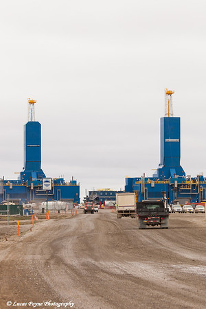 Parker Drilling rigs and trucks driving on the road in Deadhorse, Prudhoe Bay Oil Field, Arctic Alaska<br /> <br /> June 27, 2012