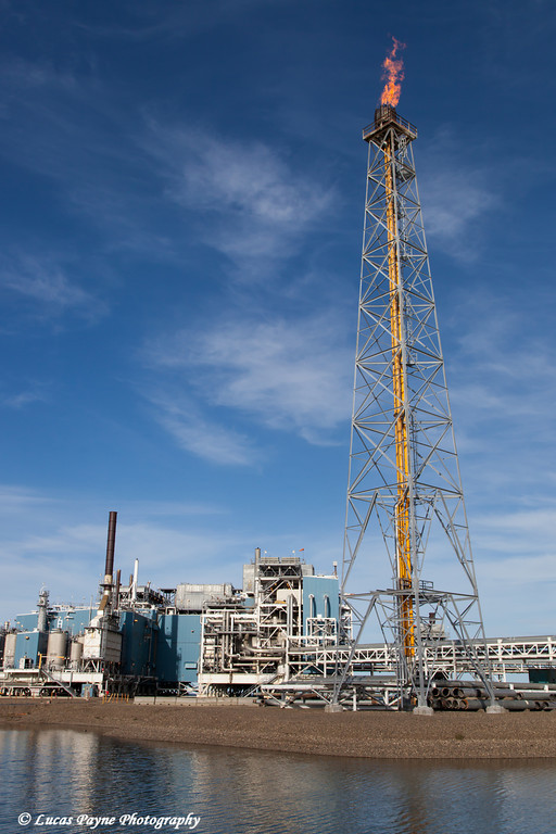 Oil production facilities and a flare tower on Endicott Island in the Prudhoe Bay Oil field, North Slope, Arctic Alaska<br /> <br /> July 28, 2012