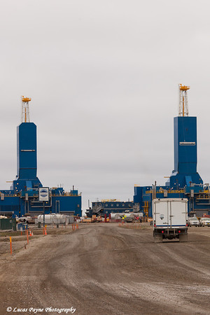 Parker Drilling rigs and a truck driving on the road in Deadhorse, Prudhoe Bay Oil Field, Arctic Alaska<br /> <br /> June 27, 2012