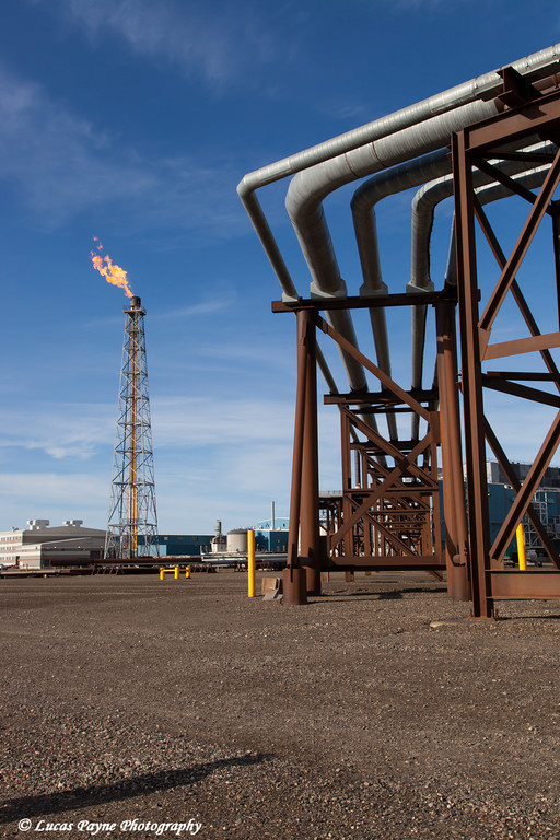 Elevated oil pipelines and a flare tower on Endicott Island in the Prudhoe Bay Oil field, North Slope, Arctic Alaska<br /> <br /> July 28, 2012