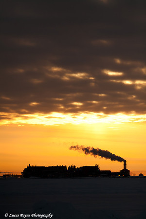 Central Gas Facility (CGF) Silhouetted By Setting Sun Prudhoe Bay<br /> February 2011