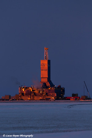 Parker Drilling Rig reflecting the early morning sun on Drill Site 1 in the Prudhoe Bay Oilfield, North Slope, Arctic Alaska.<br /> <br /> October 07, 2013