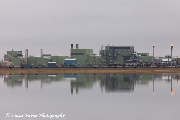 View of Gathering Center 1 (GC1) and flare towers reflecting in a pond in the Prudhoe Bay Oil Field, North Slope,  Arctic Alaska<br /> <br /> June 28, 2012
