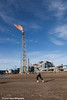 Slope worker running in the Endicott Fun Run with a flare tower and oil facilities in the background, Prudhoe Bay Oil field, North Slope, Arctic Alaska<br /> <br /> July 28, 2012