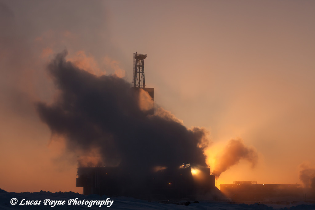 Parker Drilling Rig enshrouded in exhaust fumes on a cold day in the Prudhoe Bay Oilfield, Deadhorse, North Slope, Arctic Alaska<br /> <br /> February 07, 2013
