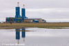 Two new Parker Drilling rigs reflecting in a pond in Deadhorse, Prudhoe Bay Oil Field, Arctic Alaska<br /> <br /> June 27, 2012