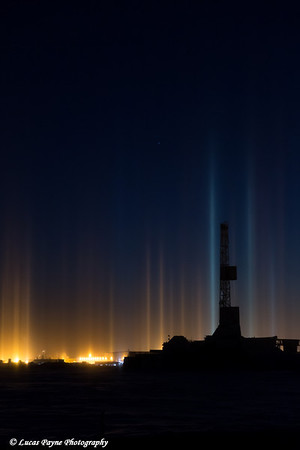 Light Pillars and a Drilling Rig in the Prudhoe Bay Oilfield, Arctic Alaska.<br /> <br /> February 04, 2014