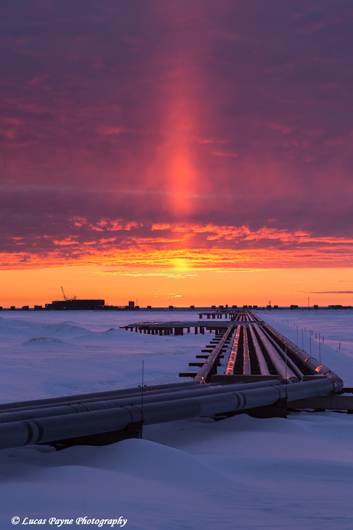 Colorful sunrise over Drill Site 9 and oil flow lines in the Prudhoe Bay Oilfield, North Slope, Arctic Alaska.<br /> <br /> October 07, 2013