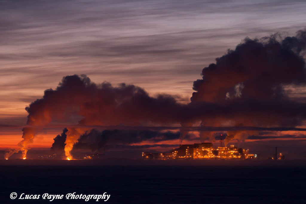 Exhaust fumes rising from the Lisburne Production Center (LPC) at dawn in the Prudhoe Bay Oil Field, North Slope, Arctic Alaska<br /> <br /> January 30, 2013