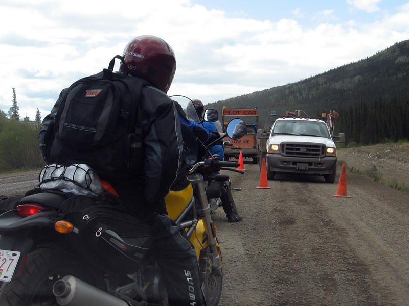 Motorcyclists readying to enter a construction zone on the Alaska Highway.