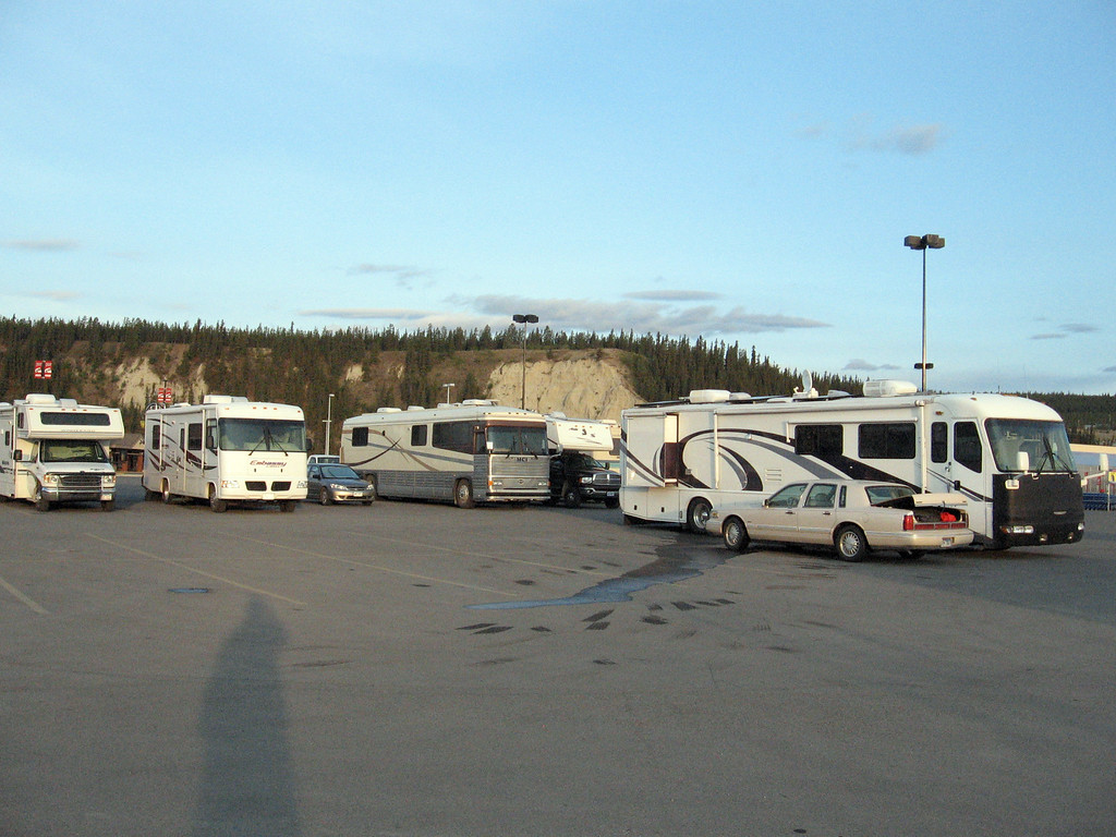 """The """"Alaska Clipper"""" (third from left) nestled in for the night at the Walmart parking lot in Whitehorse, YT."""