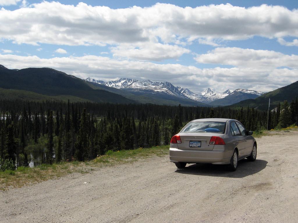 "The ""Alaska Clipper"" in the Yukon overlooking the Dawson Peaks."