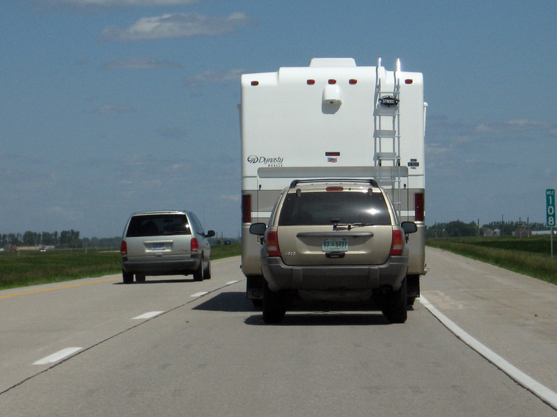 """Midwestern """"hybrid"""": Large RV towing an SUV. At least the SUV is getting good gas milage : )"""