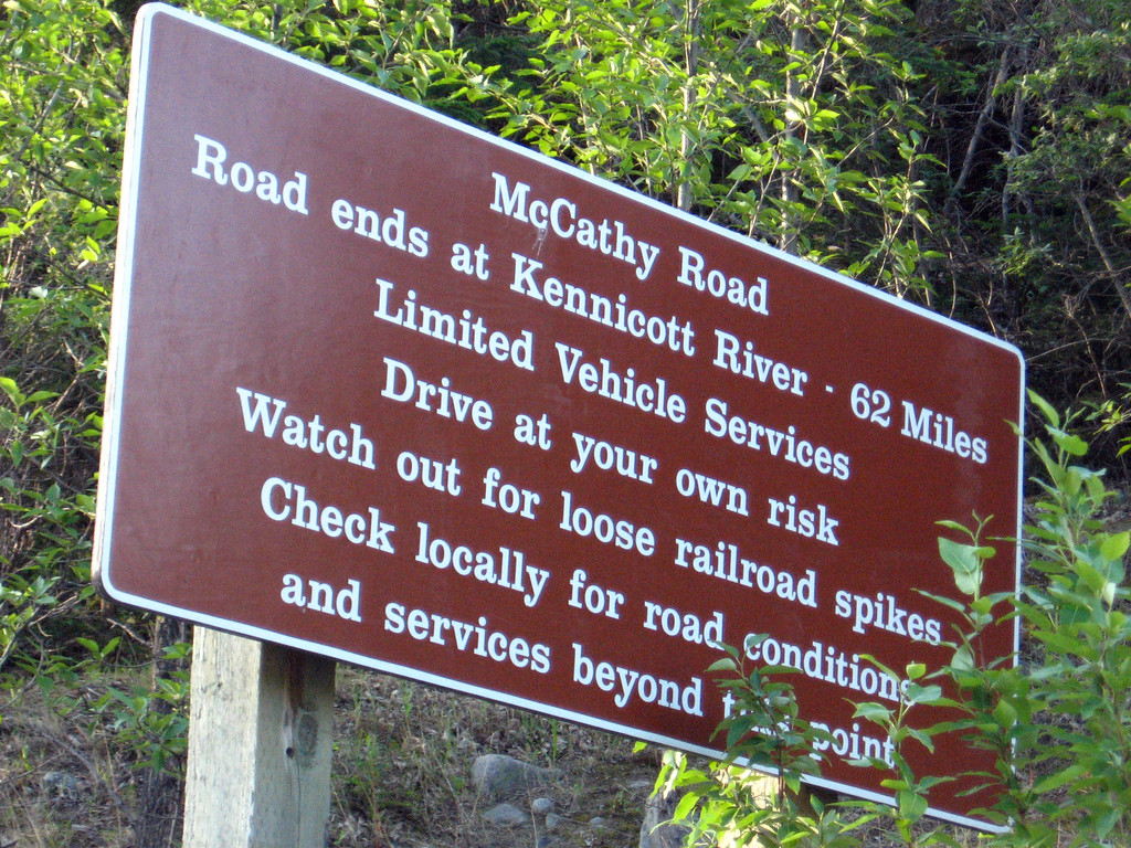 """""""Warning"""" sign at the start of the McCarthy Road."""