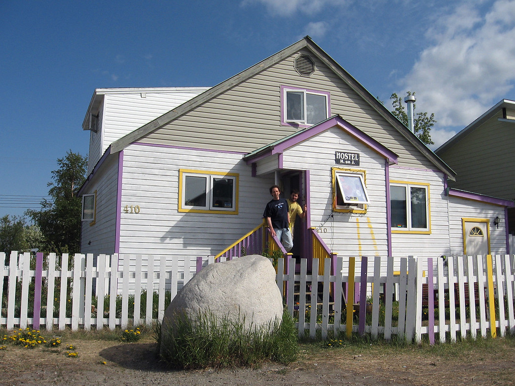 "Outside the ""Hide on Jeckell"" hostel, with owner Detlov (front) and a hostel guest. What's with the rock?"