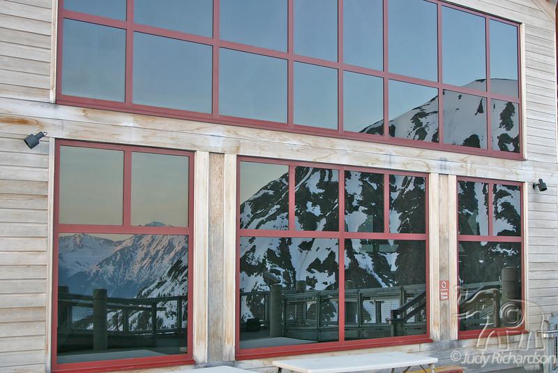 Reflections of mountains in Alyeska tram window