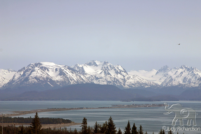 Homer, Alaska before entering town with Spit stretching out below mountains