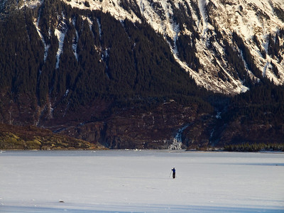 A lone skier on Mendenhall Lake before the heavy snows have come.