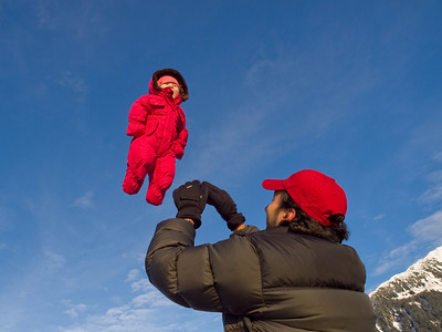 Friend Michael tosses Eva into the air by the glacier. She was squealing with delight with each toss. December 6, 2009.