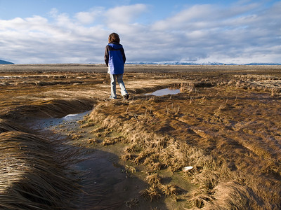 Elia walks over the tidal flats at Eagle beach, with some nice November light from the side. November 8th, 2009.