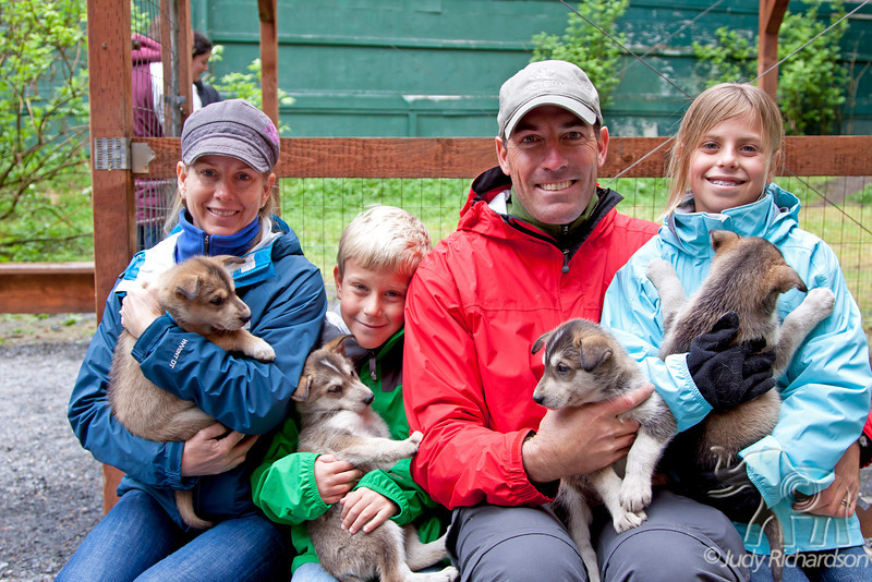 Jen, Aiden, Jeff, & Alexa with pups at Seavey's Kennels in Seward, Alaska