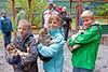 Kyle, Alexa, & Aiden with Seavey's pups in Seward, Alaska.