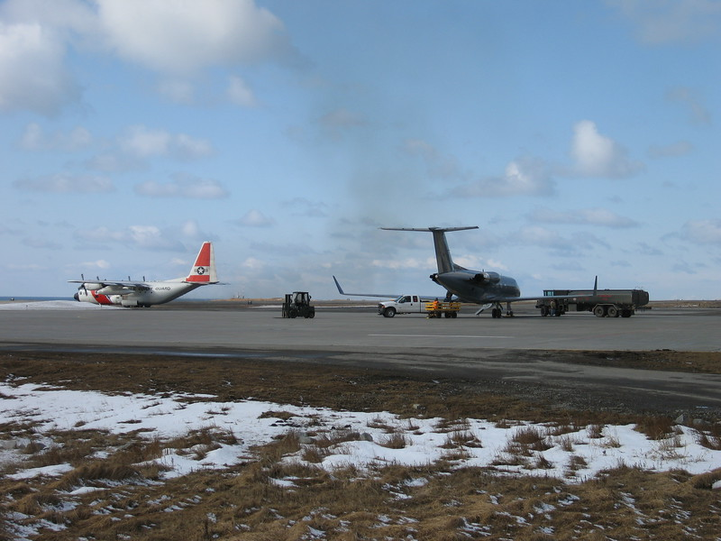 Plane on the left is the Coast Guard C-130 taxiing out to the runway to take off.  Plane on right is the G-3 again refueling to head back to Anchorage with passengers.