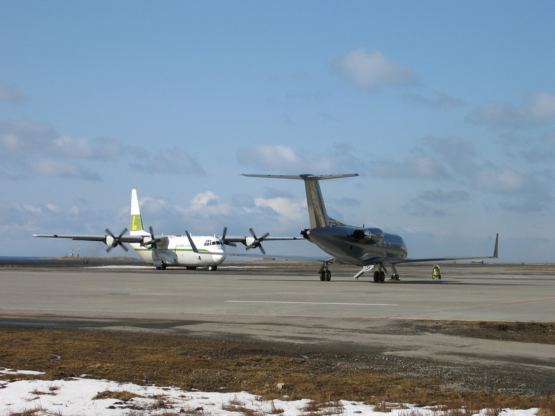 On the left is the Lynden Air Cargo plane arriving at Shemya with supplies and mail.  On the right is the G-3 again getting ready to fly back to Anchorage.