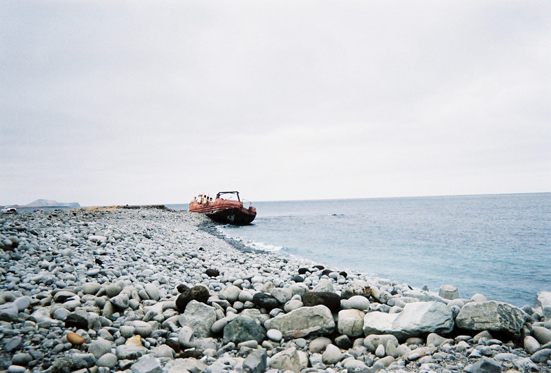 Old fishing boat washed up on shore of Shemya Island