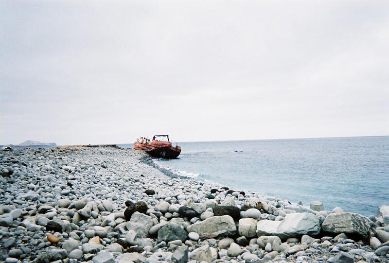 Old fishing boat washed up on shore of Shemya Island