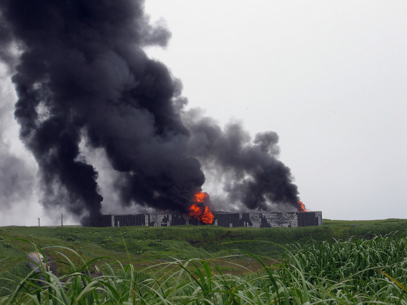 Controlled burning of one of the old warehouses on Shemya Island.