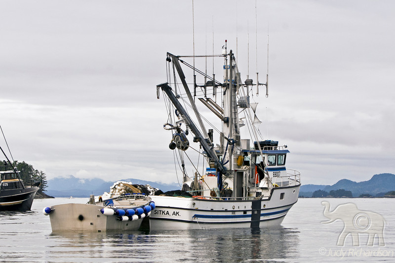 Fishing boat loaded with nets ready to work