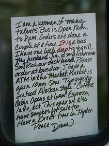 A sign left by the owner of Seafood Express, a bus converted to a lunch counter. Not open on Sundays though.