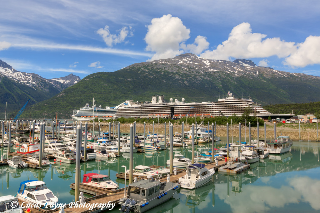 The small boat harbor and Cruise Ships docked at the Port of Skagway, Southeast Alaska.<br /> <br /> July 01, 2014