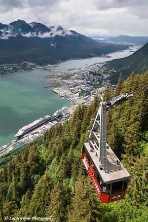 View of the Mount Roberts Tramway above Juneau and cruise ships in Gastineau Channel, Southeast Alaska.<br /> <br /> July 03, 2014